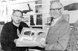 Tewi Nicholls (left) and Arthur Reid with artefacts