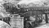 Public Works Train on the bridge unloading coal for Waihi. c.1904