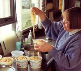 Elaine Staples preparing breakfast for the wekas